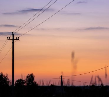 silhouette-of-electric-pole-on-meadow-at-sunset-electricity-nature-sunset-concept-air-background_t20_QKKX3m